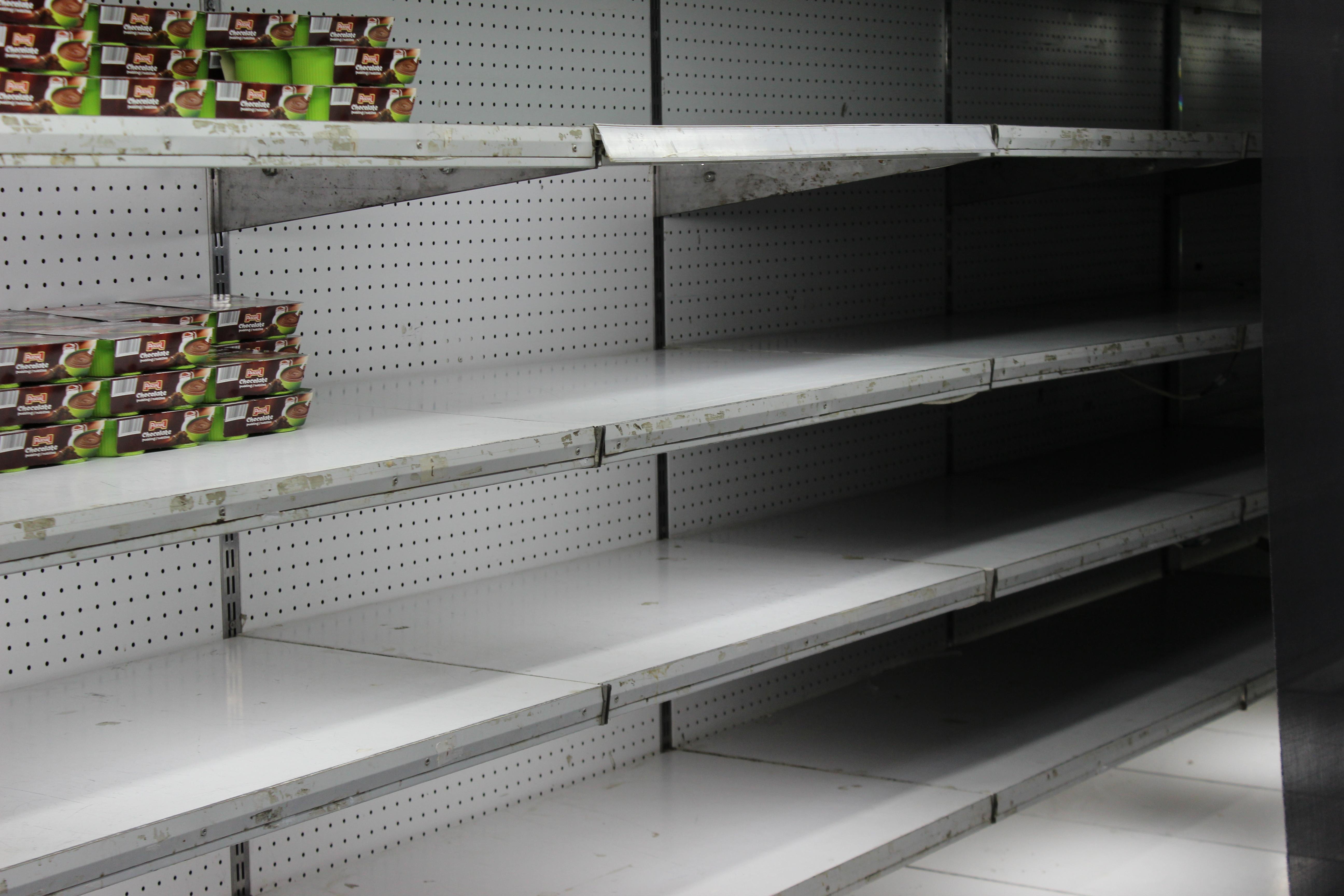 Empty grocery shelves in a grocery store in Havana, Cuba.