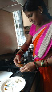 Ranuka prepares turmeric pills and blanched almonds