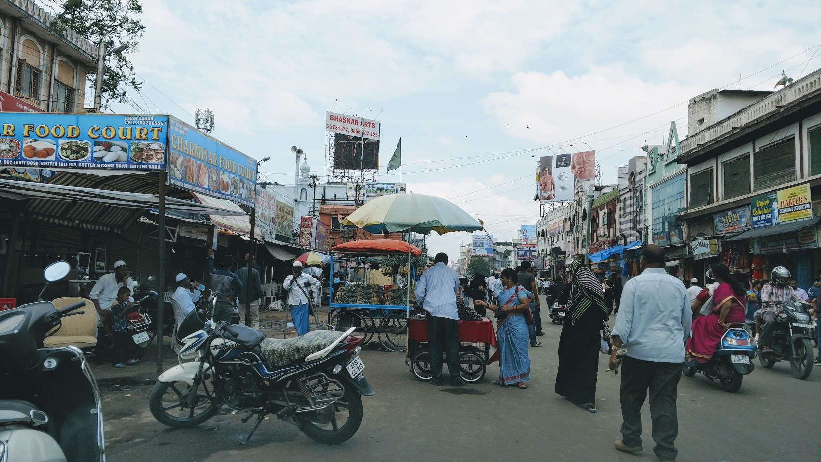 We drive through the chaotic Charminar market in the old Muslim sector of Hyderabad, dodging pedestrians, other cars, scooters, and dogs.