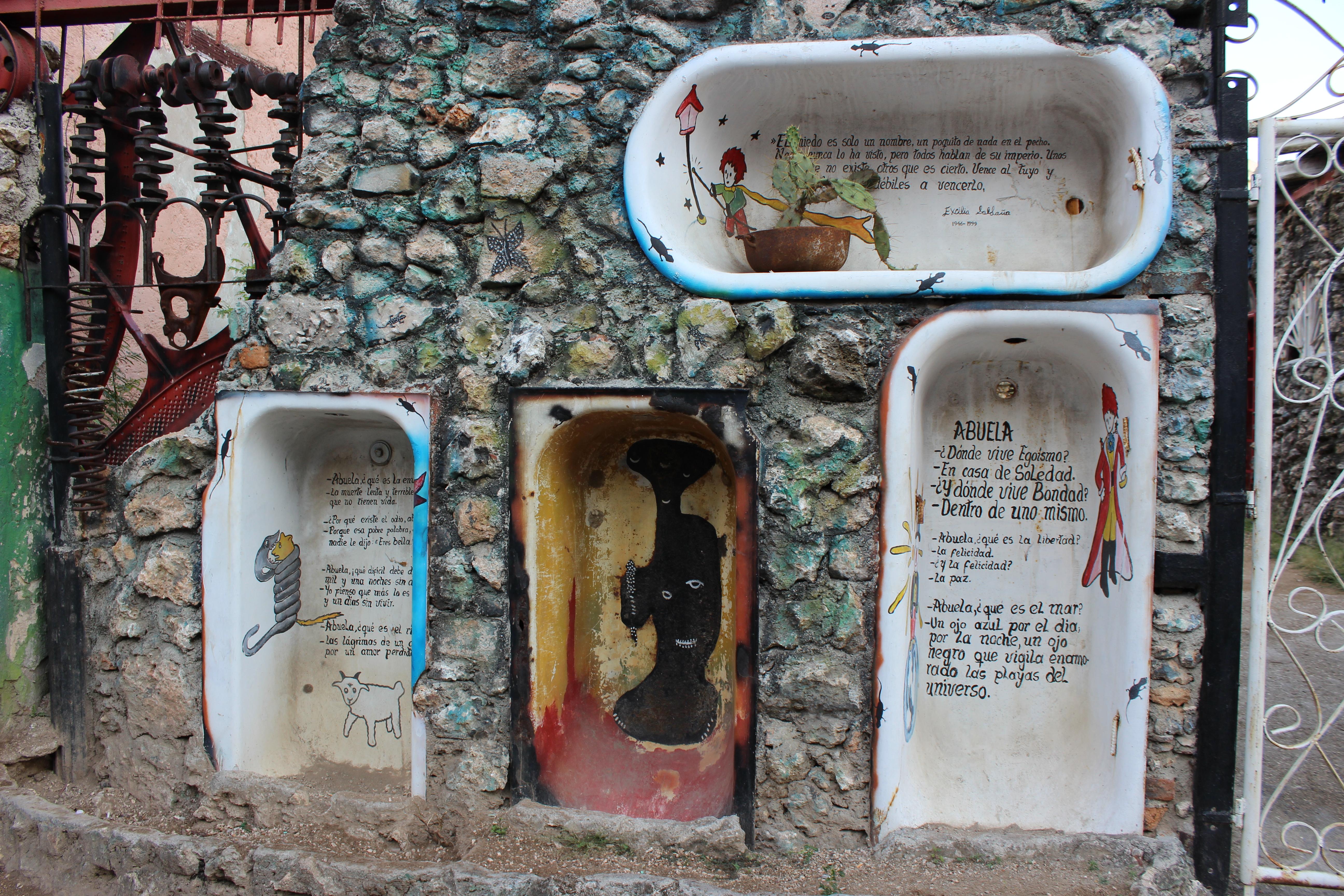 El Callejon Hammel features found art, like these bathtub-like niches.