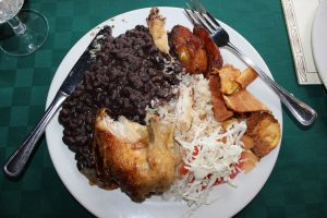 My first Cuban meal was the classic roast chicken in sour orange sauce with black beans and rice at El Aljibe.