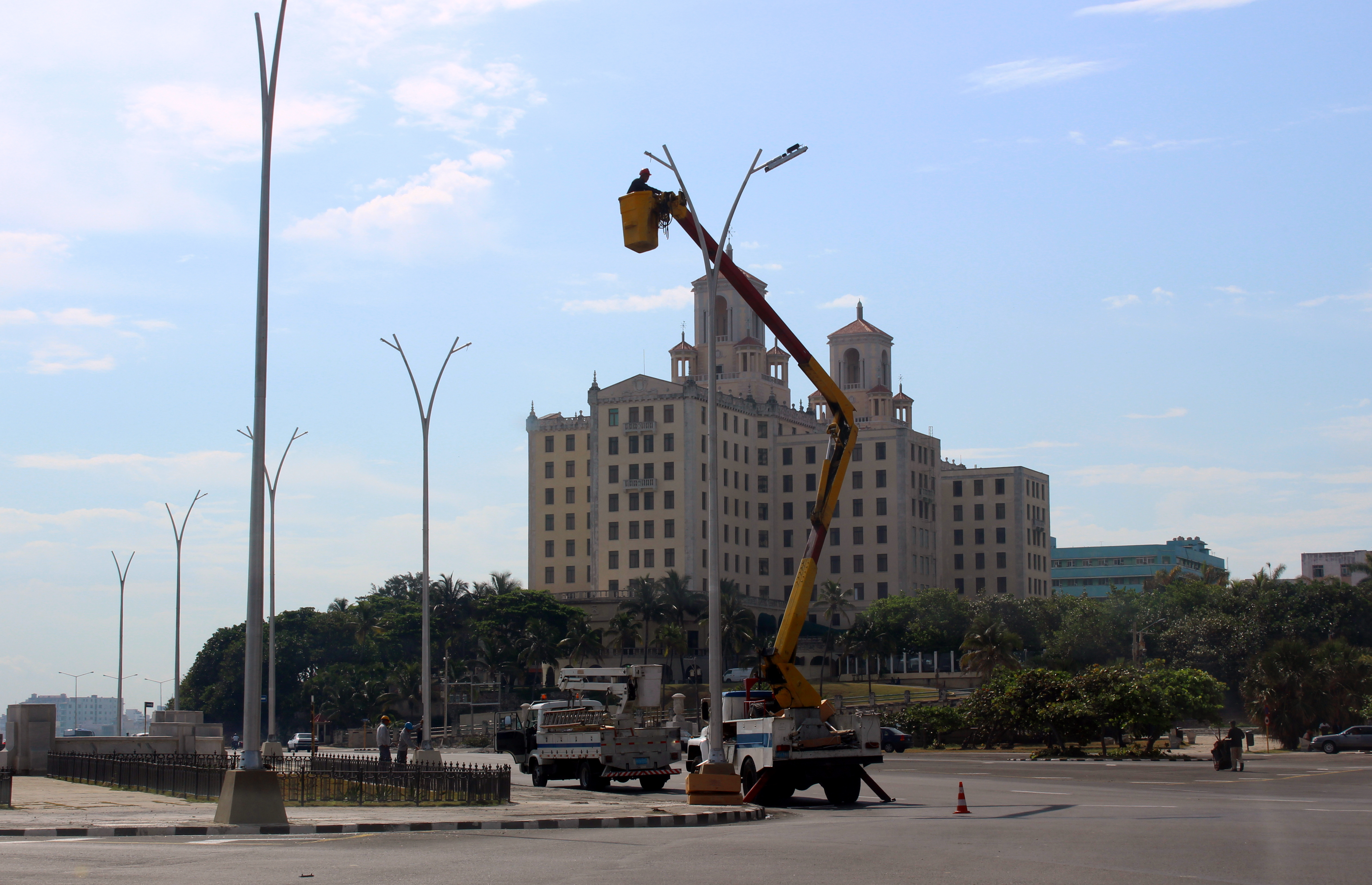 Street lights are installed in front of the Hotel Nacional in time for the May 1st observation.