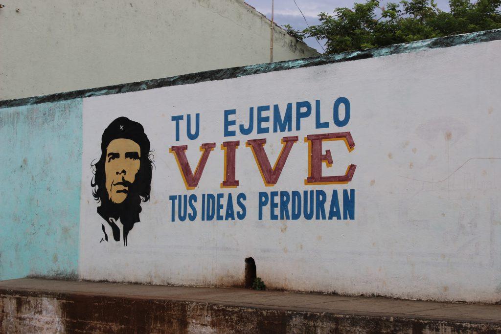 "Example of political propaganda: [Che Guevara] ""Your example lives, your ideas endure."""